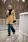 Mulher nova com telefone Fotos de Stock Royalty Free