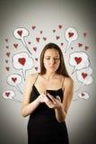 Mulher nova com telefone Imagem de Stock