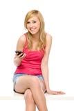 Mulher nova com telefone móvel Foto de Stock Royalty Free