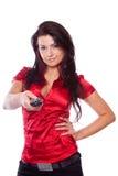 Mulher nova com a tevê de controle remoto foto de stock