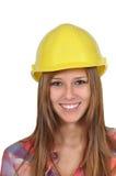 Mulher nova com um capacete amarelo Imagens de Stock Royalty Free