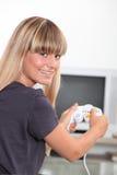 Mulher nova com um console dos jogos Fotos de Stock Royalty Free