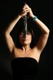 A mulher nova com um punhal Fotografia de Stock Royalty Free