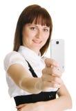 Mulher nova com um telefone móvel Fotos de Stock Royalty Free