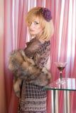 Mulher nova com um vidro do conhaque Imagem de Stock Royalty Free