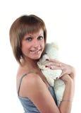 Mulher nova com urso de peluche Fotografia de Stock
