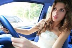 A mulher nova conduz um carro Imagens de Stock Royalty Free