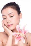 Mulher nova da beleza com flor Imagem de Stock Royalty Free