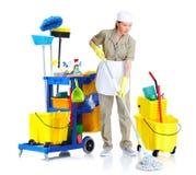 Mulher nova da empregada doméstica do líquido de limpeza. Imagem de Stock