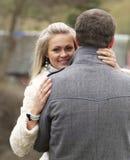 Mulher nova de de trás seu noivo Foto de Stock Royalty Free