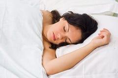 Mulher nova de sono Fotos de Stock