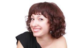 Mulher nova de sorriso com cabelos curly Fotografia de Stock Royalty Free