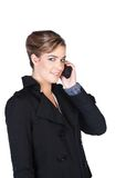 Mulher nova de sorriso com telemóvel Fotografia de Stock