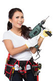 Mulher nova do construtor com uma broca Fotografia de Stock Royalty Free