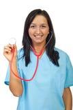 Mulher nova do doutor que mostra o estetoscópio Fotografia de Stock Royalty Free
