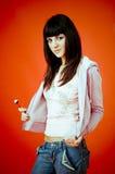 Mulher nova e seu lollipop.   imagem de stock royalty free