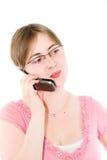 Mulher nova e telefone Fotografia de Stock Royalty Free