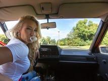 Mulher nova em seu carro Imagens de Stock Royalty Free