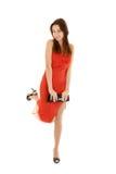 Mulher nova em um vestido de noite vermelho fotos de stock royalty free