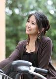 Mulher nova em uma bicicleta Foto de Stock Royalty Free