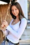 A mulher nova em uma varanda fotografia de stock royalty free