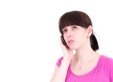 A mulher nova fala por um telefone móvel Imagens de Stock Royalty Free