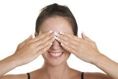 A mulher nova fecha as palmas dos olhos Fotografia de Stock
