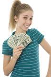 Mulher nova feliz com o ventilador de cem contas de dólar Fotografia de Stock