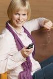 Mulher nova feliz com telefone móvel Foto de Stock Royalty Free
