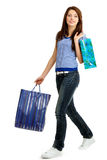Mulher nova feliz de compra Foto de Stock
