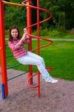 Mulher nova feliz no campo de jogos Foto de Stock Royalty Free