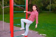 Mulher nova feliz no campo de jogos Fotos de Stock Royalty Free