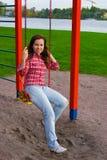 Mulher nova feliz no campo de jogos Fotografia de Stock Royalty Free