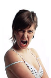 Mulher nova gritando irritada isolada no branco Imagem de Stock Royalty Free