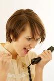 Mulher nova irritada com um telefone Fotos de Stock Royalty Free