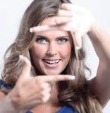 A mulher nova molda sua face com mãos Fotografia de Stock Royalty Free