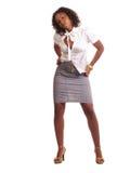 Mulher nova na saia e na parte superior do equipamento do negócio Fotos de Stock