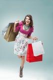 Mulher nova no equipamento colorido Imagens de Stock