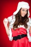 Mulher nova no levantamento do traje de Santa imagens de stock