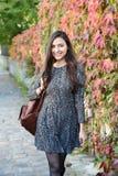 Mulher nova no outono Foto de Stock Royalty Free