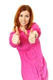 Mulher nova no polegar cor-de-rosa do vestido acima fotografia de stock royalty free