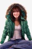 Mulher nova no revestimento verde Fotos de Stock