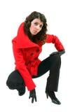 Mulher nova no revestimento vermelho à moda Foto de Stock