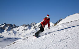 Mulher nova no snowboard Imagens de Stock Royalty Free
