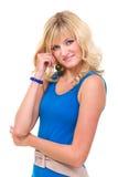 Mulher nova no sorriso azul do vestido Imagem de Stock Royalty Free