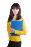 Mulher nova no terno amarelo com o dobrador do escritório. Imagens de Stock Royalty Free