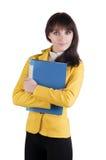 Mulher nova no terno amarelo com o dobrador do escritório. Imagem de Stock