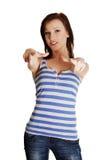 A mulher nova no vestido ocasional está apontando em você. Imagens de Stock