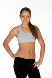 Mulher nova nos esportes sutiã e calças justas foto de stock royalty free