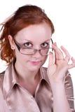 Mulher nova nos vidros foto de stock